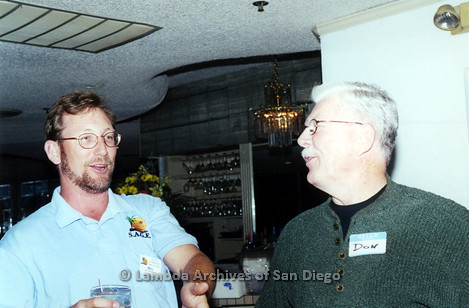 P040.050m.r.t SAGE General Meeting; 2 men, both with nametags (from left to right: Bill Marrow and Don)