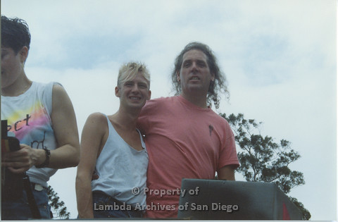 P001.056m.r Pride 1991: 3 people on the Aids Foundation San Diego Parade Float