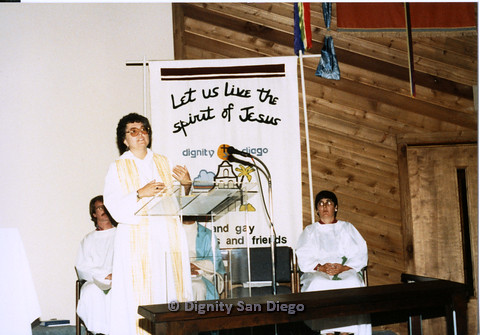 P103.029m.r.t Dignity San Diego: Female church leader speaking to the congregation