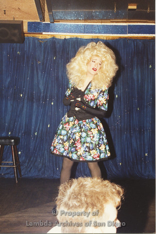 P001.255m.r.t Through The Years Fundraiser: drag queen wearing a blonde wig and floral dress