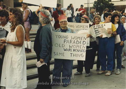 P024.096m.r.t Myth California Protest, San Diego, June 1986: Barbara McDonald holding a sign, Muriel Fisher, Mindy Rizumna and Benita Berkson