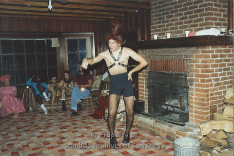P001.234m.r.t Retreat 1991: man dressed in drag with leather halter and a red beehive wig