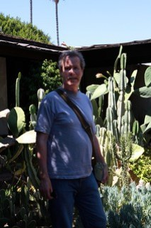 Man with cactus at oldest house in LA