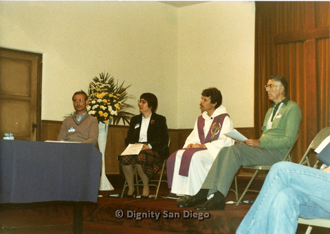 P103.002m.r.t Dignity San Diego: Three men, a woman, and a priest sitting inside church