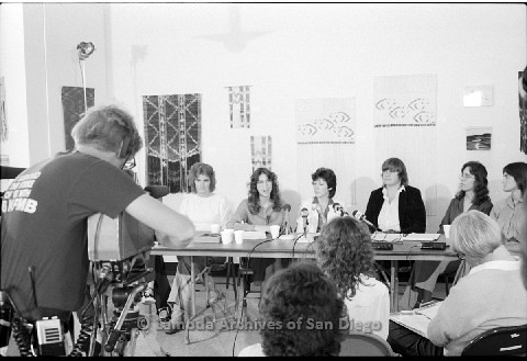 P123.015m.r.t Dixon Press Conference 1982:  (Left to Right)Chris Russell, Kathy Gilberd (MLTF, NLG), Diane Cooper (NOW/SD), Susan McGreivy (ACLU), Kim McAlister (CWSS), Eileen Bingle listening while Kathy speaks.