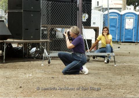 P024.435m.r.t 1990 San Diego Pride festival: Sheila Clark taking a picture