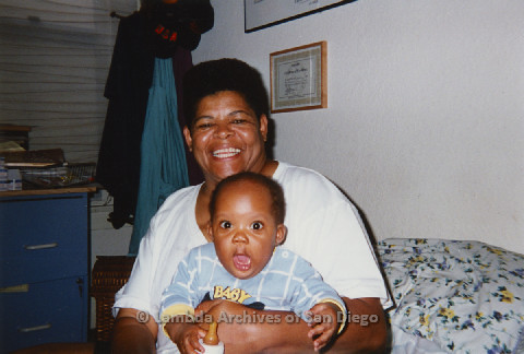 P125.030m.r.t Phyllis Jackson smiling widely at the camera while baby Natasha Taylor is wide-mouthed