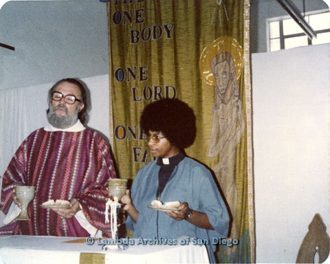 P110.055m.r.t Metropolitan Community Church: Joseph Gilbert and religious leader holding wine and bread.