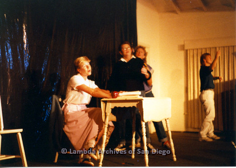 P024.170m.r.t Ellie Rapp (third from left) with others on stage