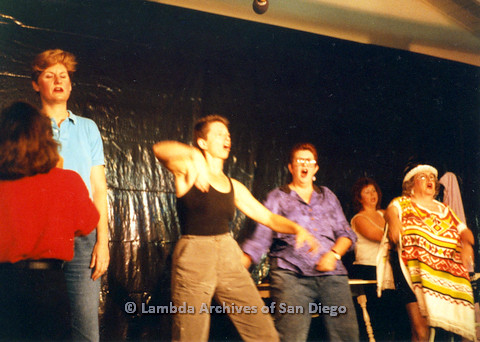 P024.182m.r.t Judith McConnell (in blue), with Kithy Gately (in black), and Muriel Fisher (in colorful poncho) performing on stage