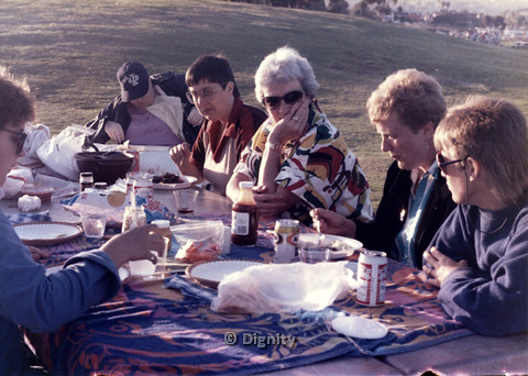 P104.031m.r.t Dignity San Diego: Picture of women sitting and eating around a public table