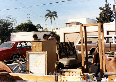 P104.003m.r.t Dignity church and MCC yard sale: three men looking through wooden furniture