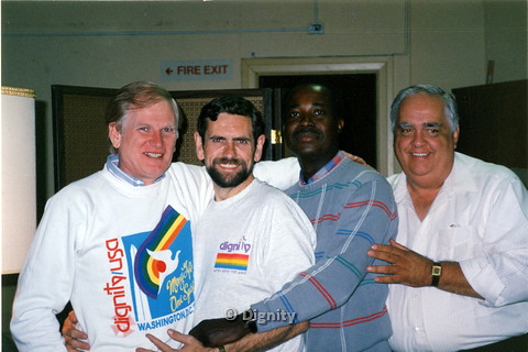P104.195m.r.t Dignity San Diego: Four men standing and embracing eachother,the first two on the left wearing Dignity USA shirts, Stan Lewis, and another man.