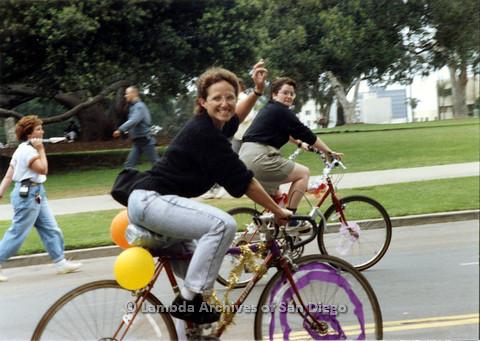 P024.498m.r.t 1990 San Diego Pride: Two women in black shirts on bikes