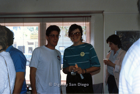 "P103.194m.r.t Dignity San Diego: Woman wearing button ""Neil Good City Council"" smiling at camera with a man"
