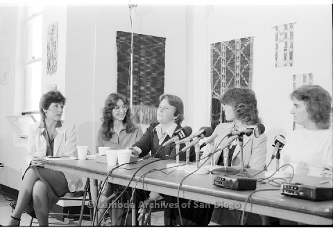 P123.022m.r.t Dixon Press Conference 1982:  (Left to Right) Diane Cooper (NOW/SD), Kathy Gilberd (MLTF, NLG), Robin Bruce, Fran Ledford, and Chris Russell looking at Robin.