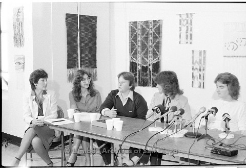 P123.024m.r.t Dixon Press Conference 1982:  (Left to Right) Diane Cooper (NOW/SD), Kathy Gilberd (MLTF, NLG), Robin Bruce, Fran Ledford, and Chris Russell listening to Robin.