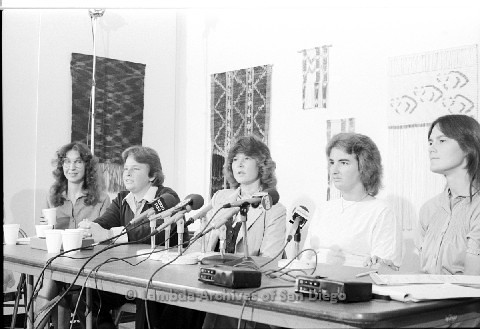 P123.021m.r.t Dixon Press Conference 1982:  (Left to Right) Kim McAlister (CWSS), Robin Bruce, Fran Ledford, Chris Russell and  Eileen Bingle looking at audience.