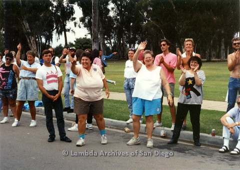 P024.483m.r.t 1990 San Diego Pride Parade: People alongside the street clapping and waving