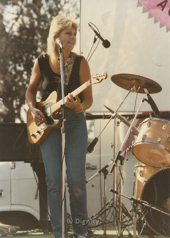 P104.151m.r.t San Diego Pride Festival 1989:Woman with guitar standing before drum set.