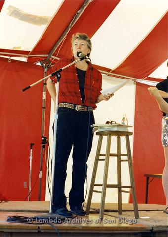 P024.253m.r.t  Judy Grahn standing at microphone beside ASL translator (far right).