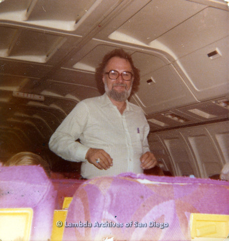 P110.042m.r.t Metropolitan Community Church: Joseph Gilbert standing in airplane.
