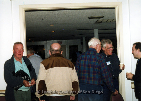 P040.127m.r.t SAGE General Meeting; men socializing