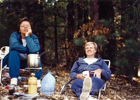 P024.290m.r.t Sally Hopkins (right) and woman sitting at a campsite