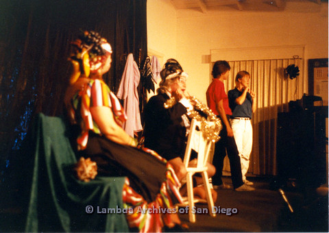 P024.172m.r.t Performers in different costumes sitting on stage