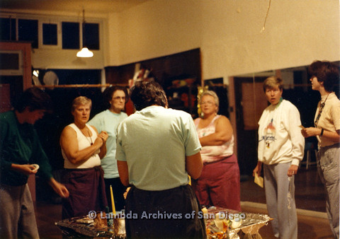 P024.308m.r.t Sally Hopkins (white tank-top left), Ila Suzanne (center, facing), and Karen Belcher (to right of Ila) standing in a circle.