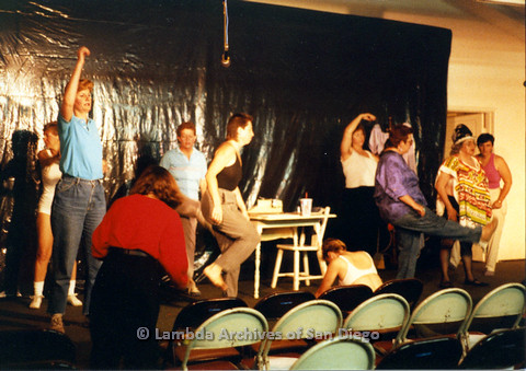 P024.153m.r.t  Larger group of people, with Diane F. Germain in white tank top, Judith McConnell in blue collared shirt, and Kithy Gately rehearsing on stage, Karen Belcher sitting faced away