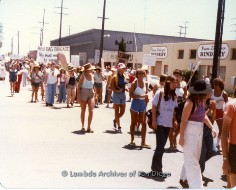 "P109.025m.r.t San Diego Pride Parade 1978: In the midst of parade with prominent ""Paper Bag Brigade"" banner."
