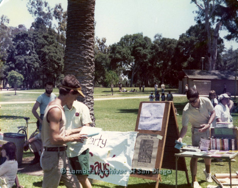 "P109.004m.r.t San Diego Pride Festival 1976: Gathering in Balboa Park with ""Party Gays"" sign."