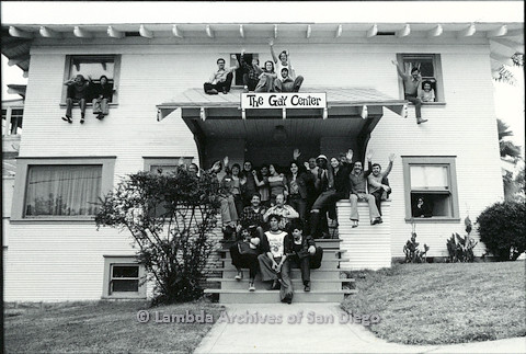 "P108.001m.r.t  People sitting on the steps and roof of ""The Gay Center"" in 1973."