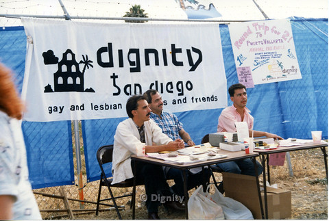 P104.015m.r.t Dignity San Diego: Three men running the Annual Raffle table