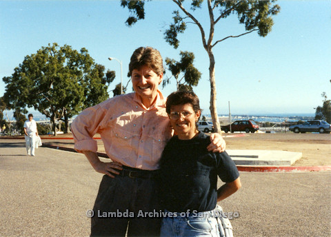 P024.520m.r.t 1990 San Diego Pride:Judith MConnell (on left) has her arm around woman in black shirt.