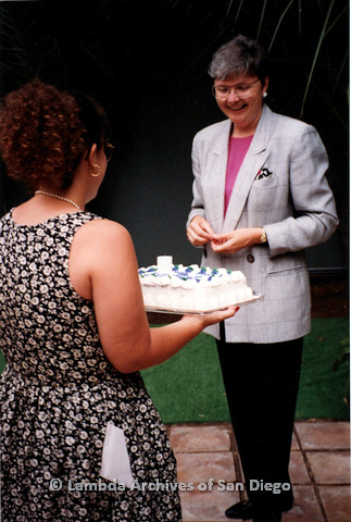 P151.046m.r.t Christine Kehoe outside being presented a cake