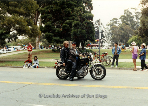 P024.422m.r.t 1990 San Diego Pride parade: Two people in leather jackets on a Yamaha motorcycle