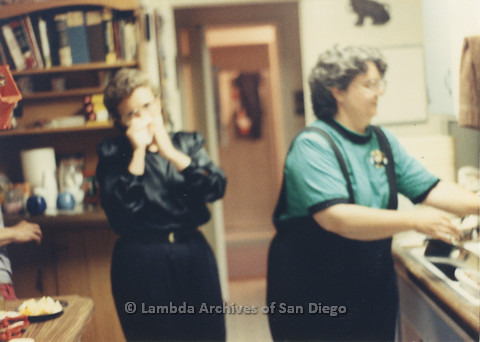 P024.367m.r.t Michael Ann (right) and another woman in a kitchen.