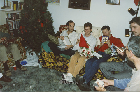 P104.088m.r.t Dignity San Diego: Five men holding opened Christmas gifts