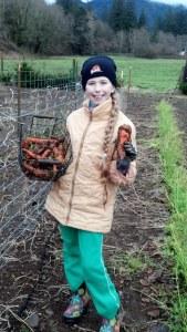 Nina digging carrots