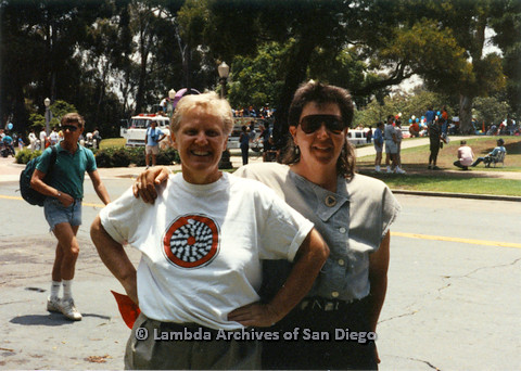 P024.516m.r.t 1990 San Diego Pride: Unknown woman wraps an arm around Sally Hopkins (on left)
