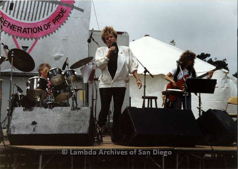 P024.398m.r.t 1989 San Diego Pride: Sue Fink performing with Leaping Lesbians on stage