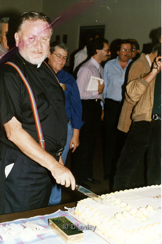 P104.167m.r.t Dignity San Diego: John McNeil cutting in to a cake at a gathering.
