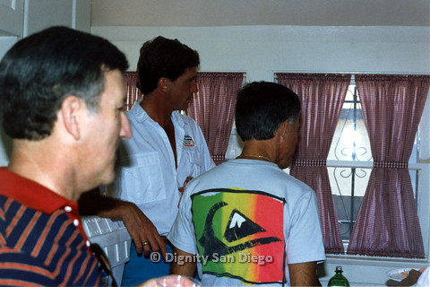 P103.196m.r.t Dignity San Diego: Three men looking at something, Christopher at center
