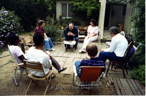 P103.079m.r.t Dignity San Diego: Group of people sitting in a circle in a backyard