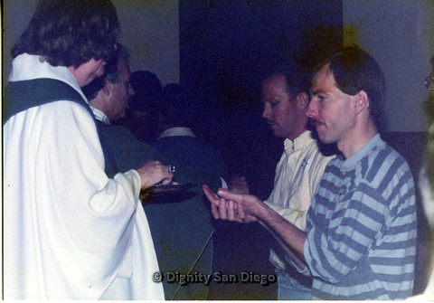 P103.031m.r.tDignity San Diego: Men receiving communion