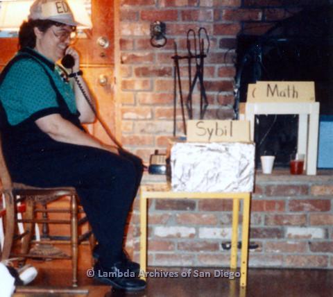 P024.389m.r.t Michael Ann holding a telephone