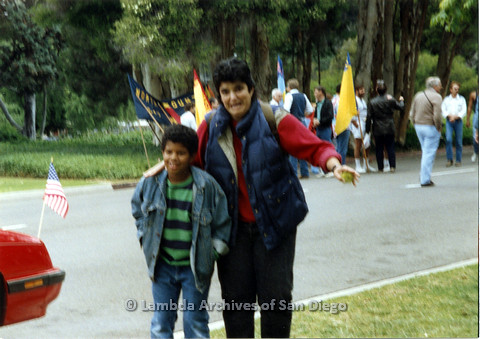 P024.444m.r.t 1990 San Diego Pride Parade: Veronica Cunningham with arm around a boy.