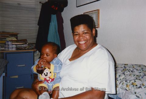 P125.029m.r.t Phyllis Jackson holding baby Natasha Taylor